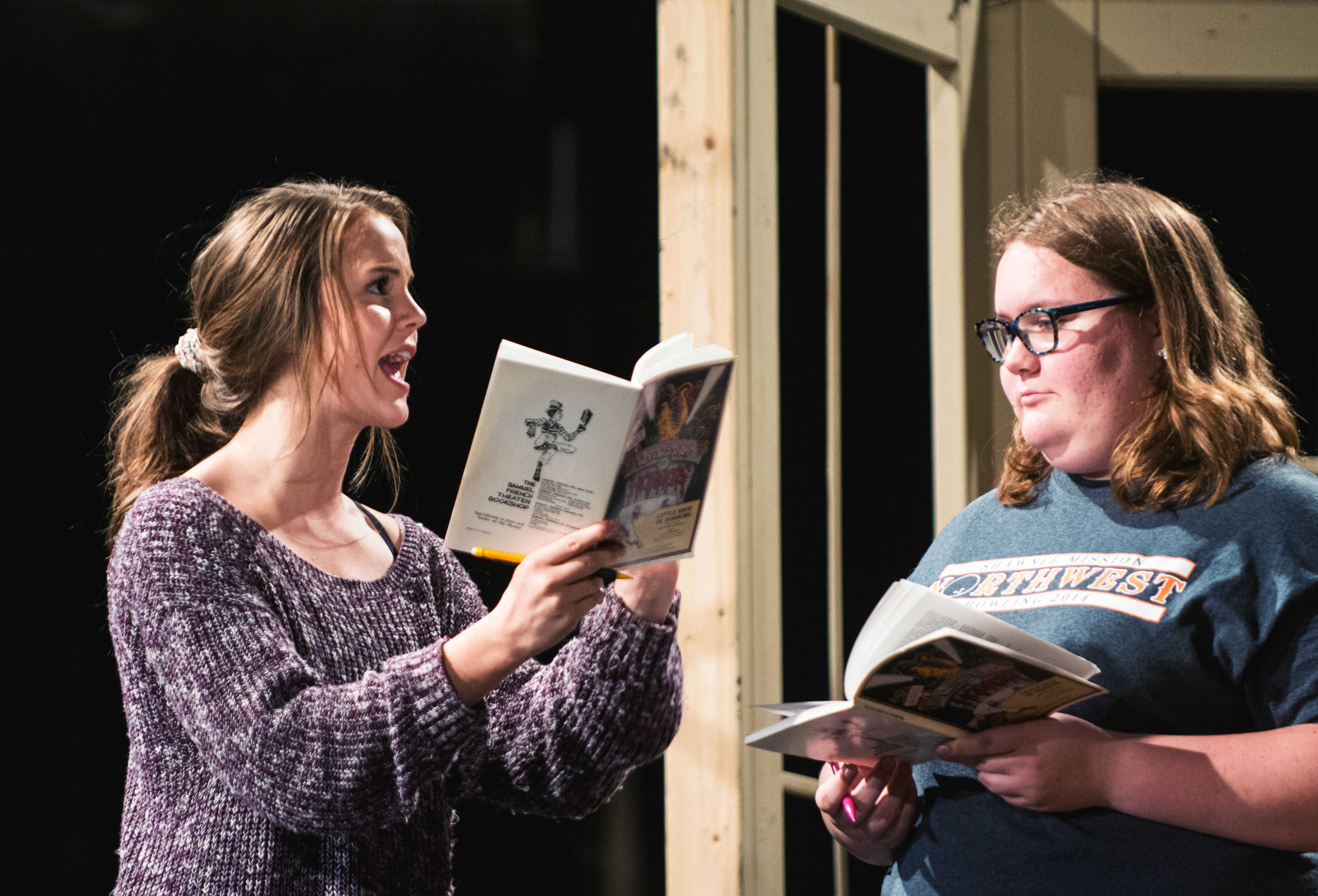 Reading from her script, senior Maggie Marx acts during the rehearsal of Little Shop of Horrors on Sept. 15. Marx portrayed the character of Audrey who has a crush on the lead male role of Seymour.
