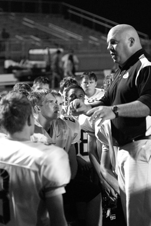 Coach Barnett talks to his players after a game.
