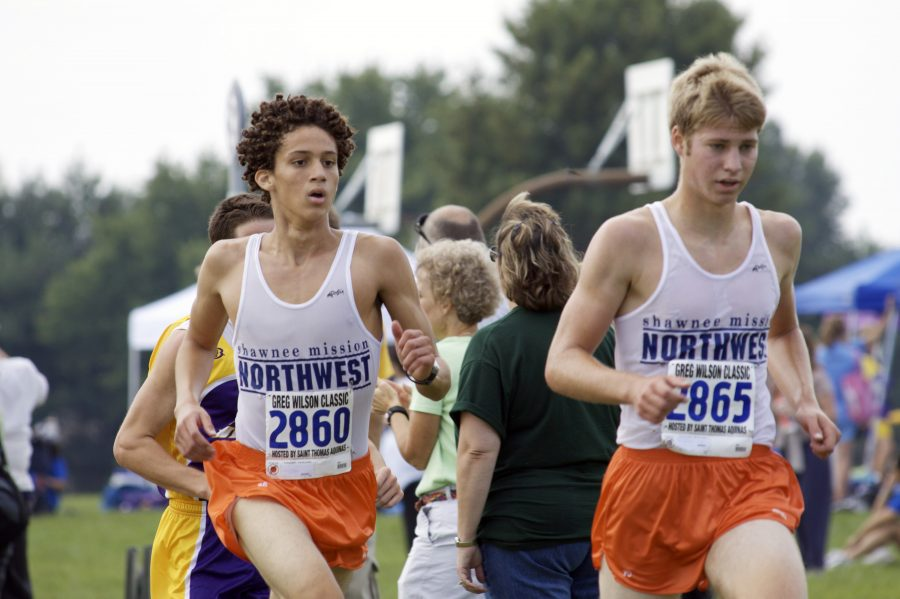 Juniors Sterling Spencer and Aaron Thornburg race to the finish line at JCCC on Sept. 5th.