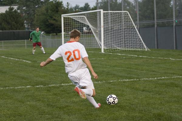 Senior Sam Mccrillis launches a shot from just outside the 18 box. Mccrillis had two goals in the Cougars victory.