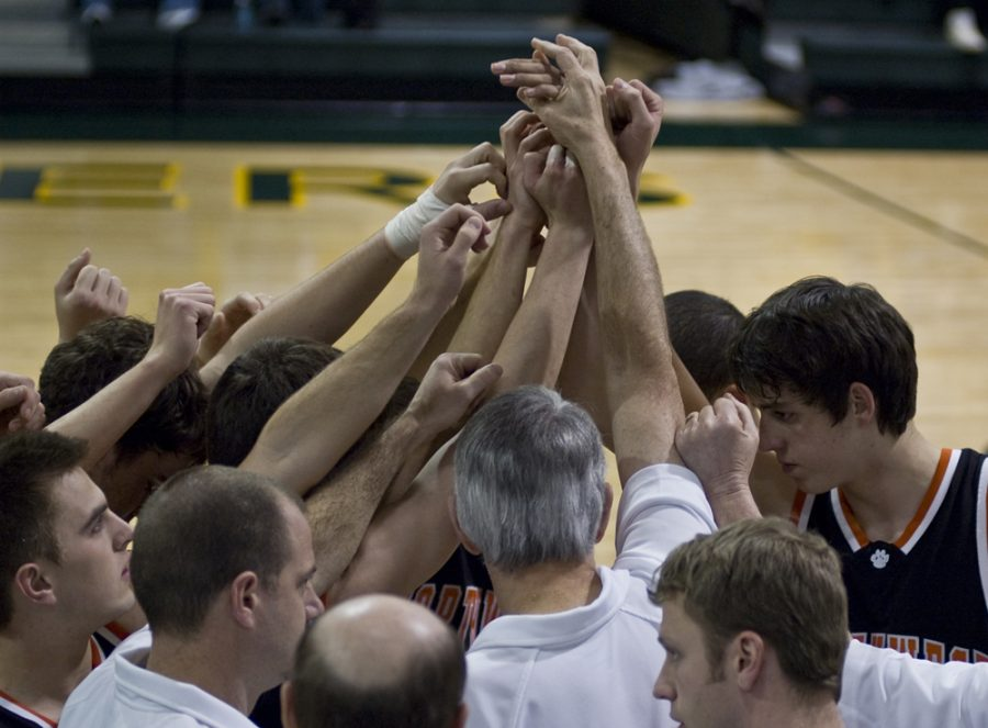 The Boy's Varsity Basketball get in a huddle before the game on Feb. 2 against South at South.  We ended up winning the game with a score of 57-27.  They are now 7-2 in thier basketball season.