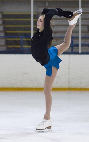 Holding her leg up, junior Amy Miller performs a Beilman spin.