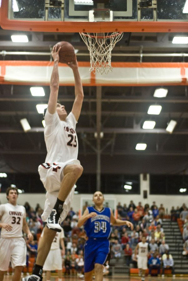 Senior Steve Carver goes up for a dunk during the second half of the last game of the season. This was his final high school basketball game.