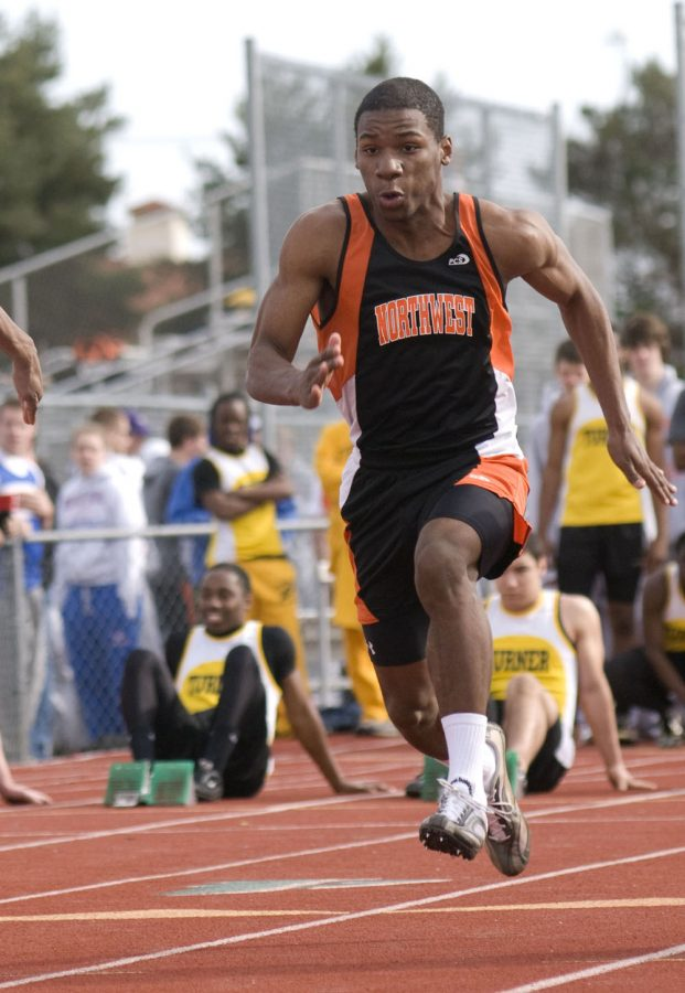 Sophomore Duan Johnson sprints during the 100-meter-dash at the SM South track meet on March 26.