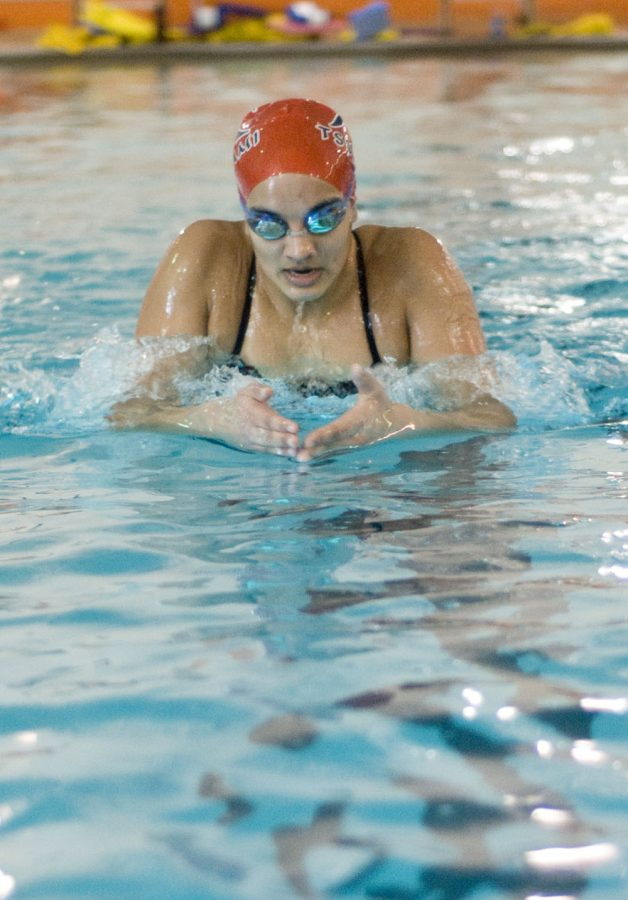 Senior Hannah Singhal practices her breast stroke on March 3.