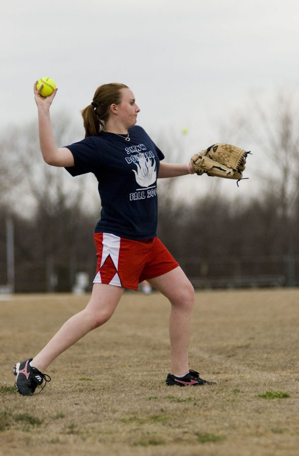 Freshmen Katt Cooper throws the  ball while playing catch at try-outs on March 20.