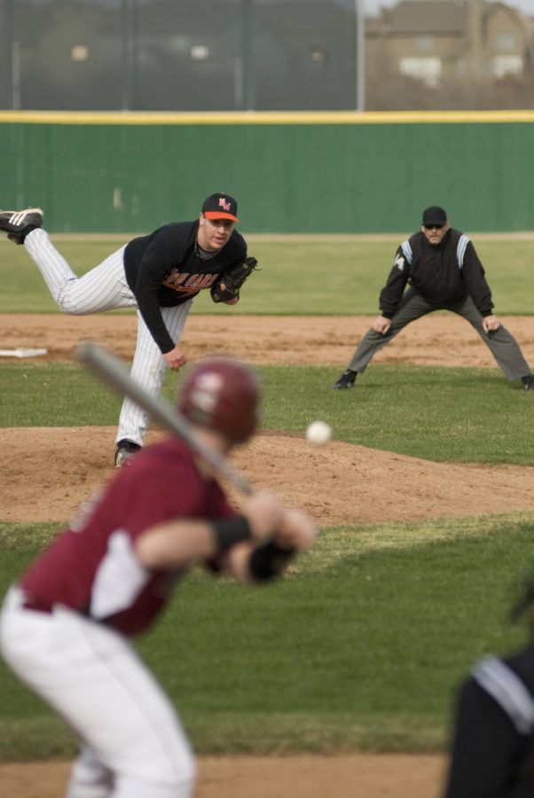 Senior Adam Giacalone delivers a pitch to a SM North batter during the season-opening game last Friday.