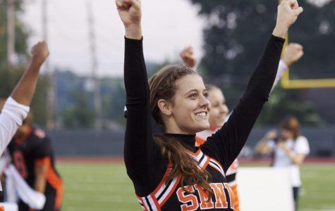 Senior Jami Borel cheering at a football game in the fall.