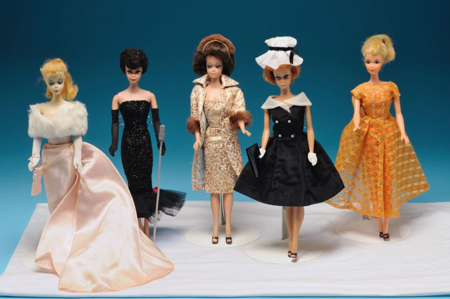 Various Barbies in fashion outfits