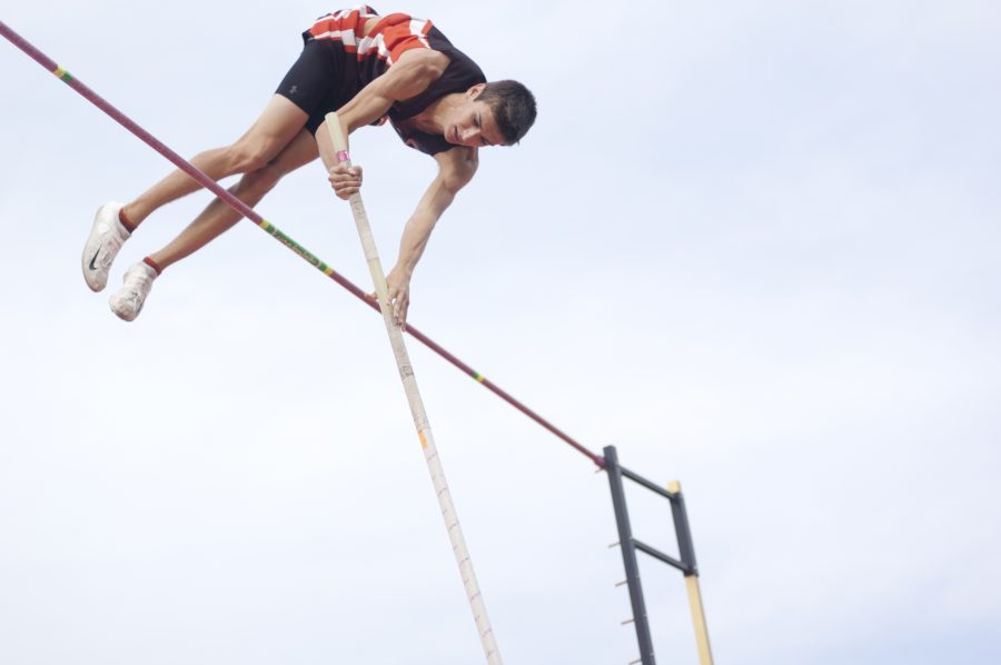 Senior Cameron Bock pole vaults at a meet.