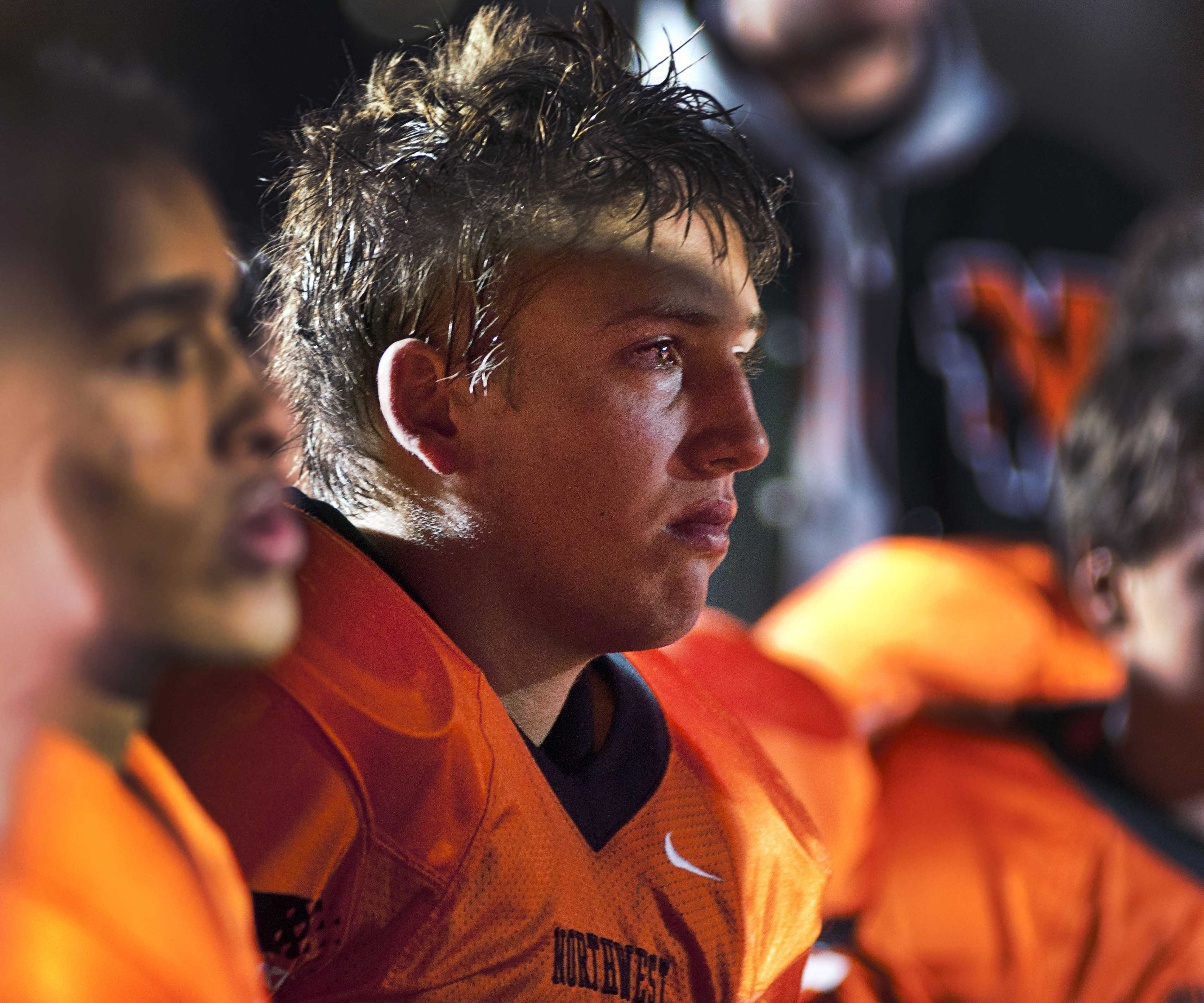 "Senior Jorn Winkelmolen reacts to the loss of Northwest's last football game of the year on Oct. 26 at SM North. The cougars lost 40-9 with a final record of 2-7. ""I was very sad because I knew I was done playing football forever,"" Winkelmolen said. ""And that really hit me hard after the last game."""