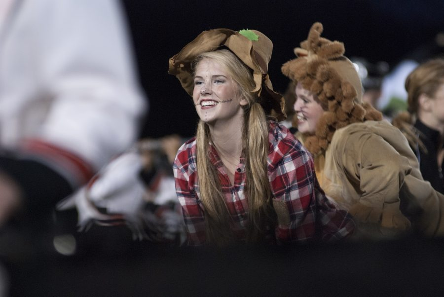 Senior Brooke Nelson smiles as she performs during the halftime show at the first varsity football game of the season on sept. 5 at SM North district stadium. The theme for the halftime show is