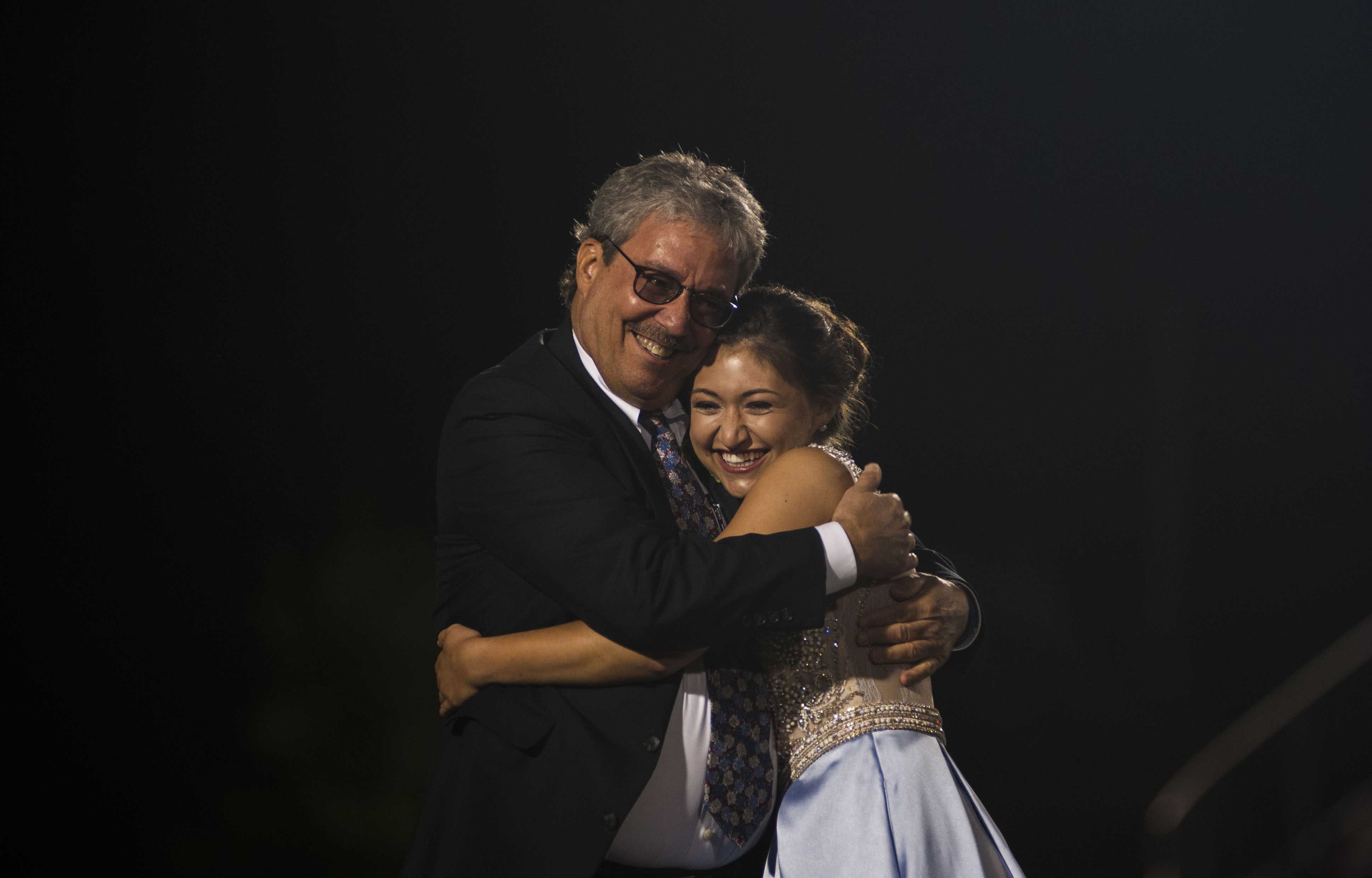 Tavin Cook hugs her father after being announced as Homecoming Queen at Friday's homecoming football game.