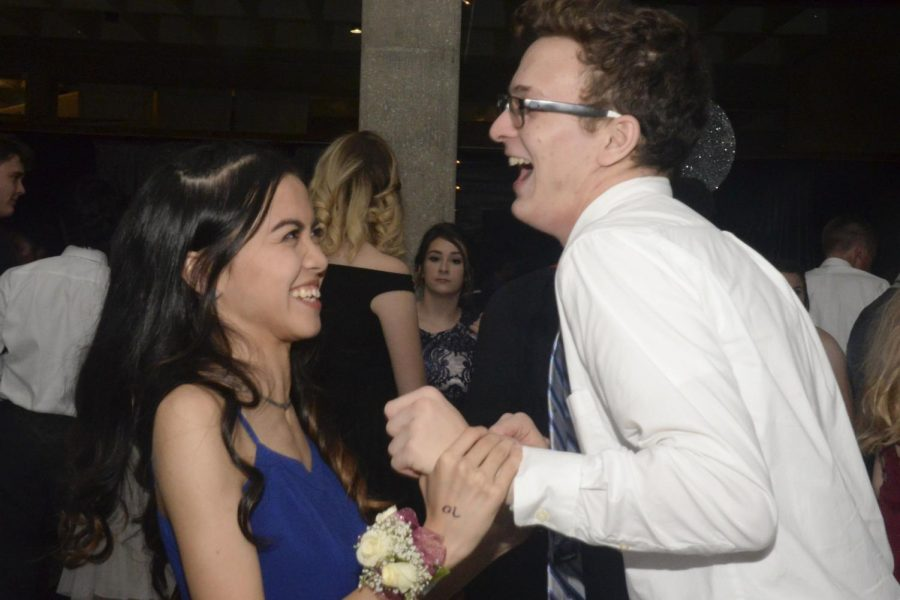 Senior Althea Flores shares a laugh with her date.