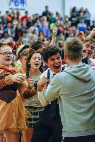 Senior Josh Sherfy with Spirit Club Exec board carries the spirit stick away from the senior class Oct. 20 in the main gym. The senior class won the spirit stick for the first time this year.