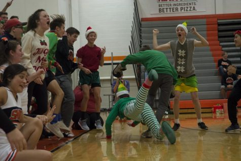 Junior Dawson Mesh riles up the junior section during their skit.