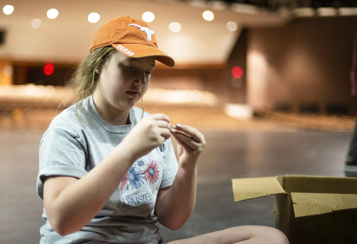 In the Greg Pakrer Auditorium, freshman Anna Holloway sits on stage Sep. 8. 'Almost, Maine' is Holloway's first show at NW.