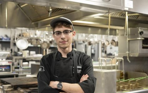 At his station, Reis Miller poses in the Broadmoor Bistro's kitchen Sep. 9. Miller has won multiple national cooking awards in first place winner of the Culinary Arts competition.