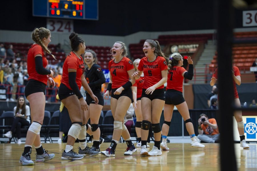 Yelling in excitement, senior Ada Heller, juniors Taylor McCarthy, Reanne DeBose and Audrey Bennett and sophomore Vivian Keiffer celebrate after DeBose scores a point Nov. 1 at Tony's Pizza Events Center. The Cougars won two out of the three matches against the Trailblazers.